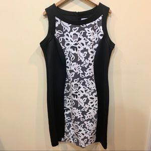 Formal sleeveless sheath dress with lace illusion